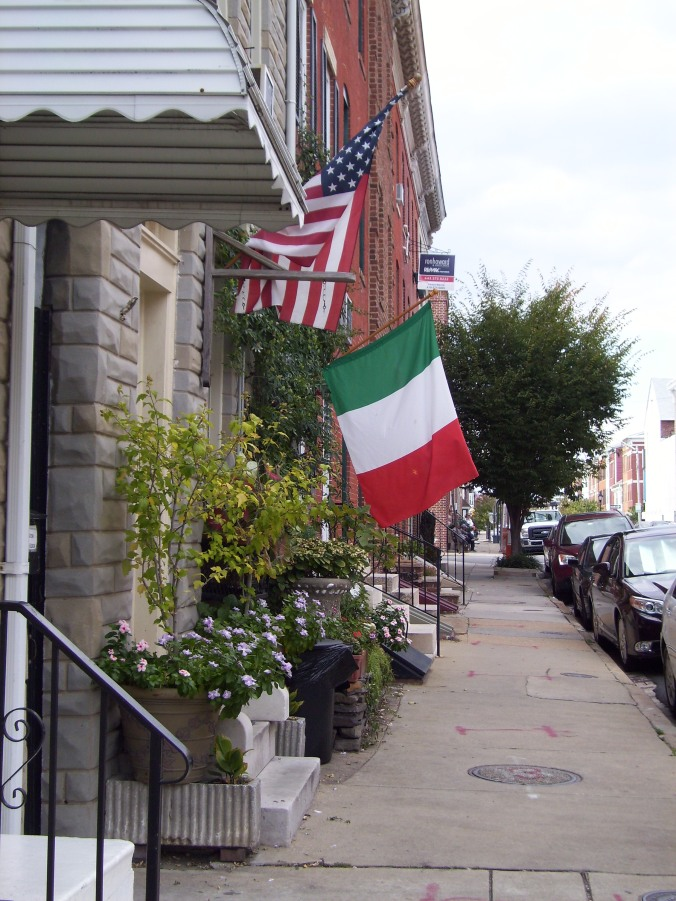 "By: Gabriela Yareliz A glorious afternoon in Baltimore's Little Italy. A good looking Italian man walked by me saying ""How are ya doin'?"" in that classic Italian-American accent. I smiled to myself the whole time in this neighborhood. Little Italy is mostly  restaurants, men loading and unloading trucks and adorable children drawing on the sidewalks with chalk."