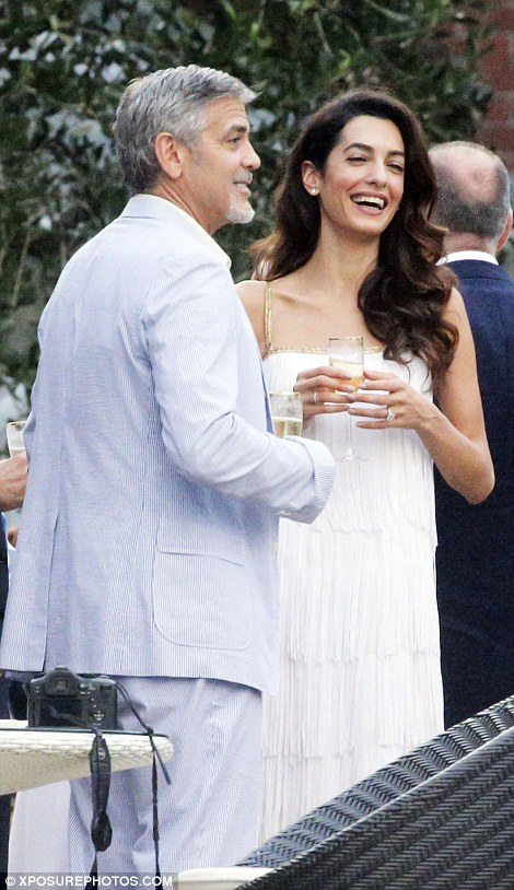 3712033300000578-3733431-the_perfect_hosts_george_clooney_had_his_stunning_wife_by_his_si-a-161_1470844610056